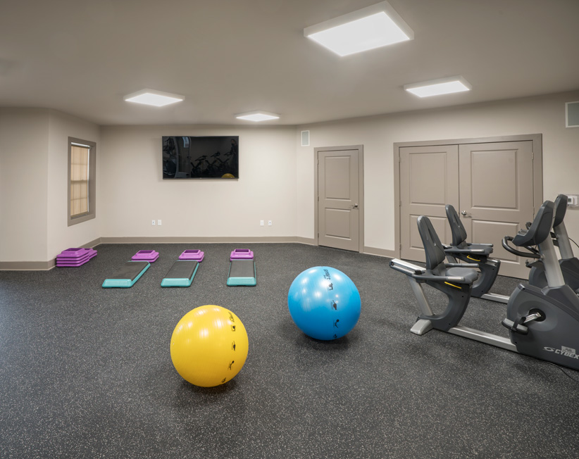 luxury apartment fitness center with yoga balls
