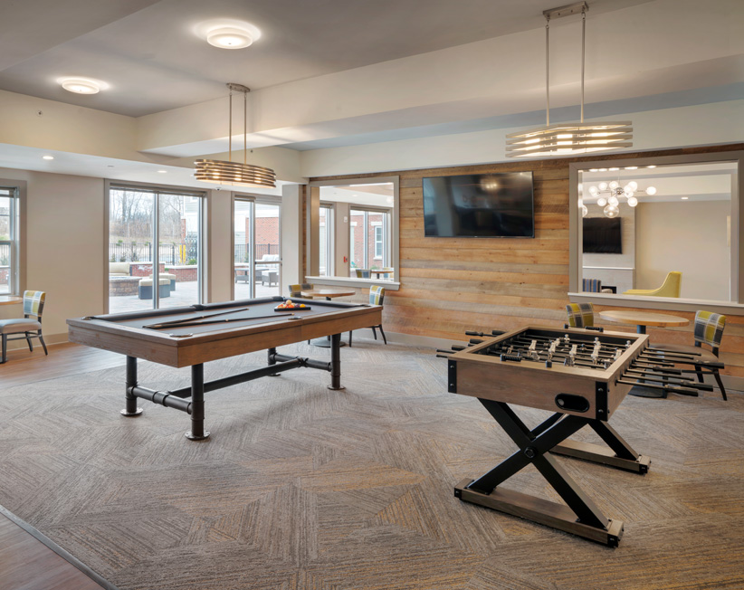 pool table and lounge area in luxury apartment building