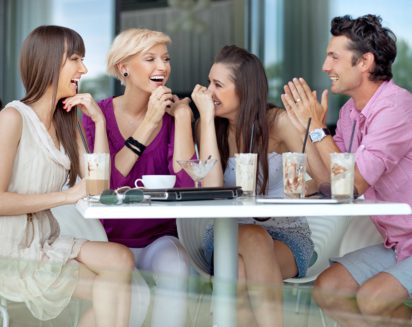 friends talking and laughing outside at cafe