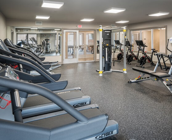 Apartment fitness center with treadmills and workout machines