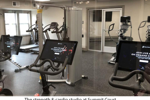 Exercise equipment in fitness center at summit court apartment building